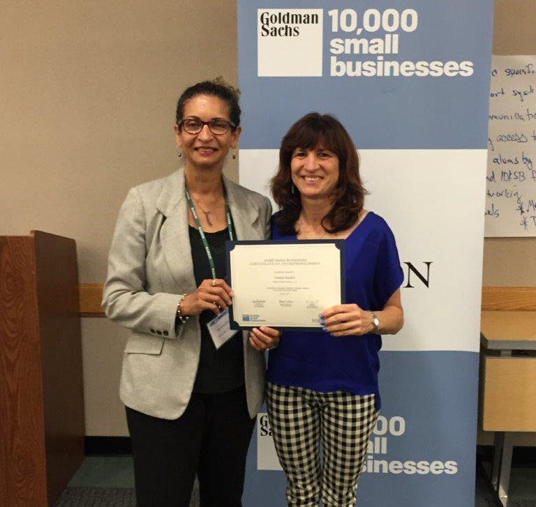Pamela Sandler accepts Goldman Sachs 10,000 small business certificate from Joy Schaaffe- Lead Faculty- 10,000 small businesses.